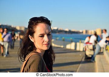 Happy woman walking on the beach pr