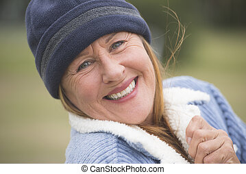 Happy woman warm bonnet and jacket outdoor - Portrait happy...