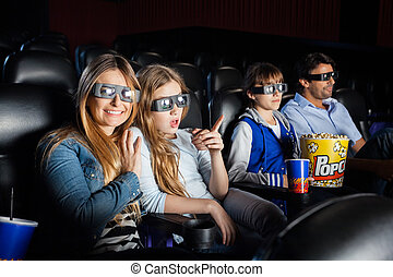 Happy Woman Watching 3D Movie With Family