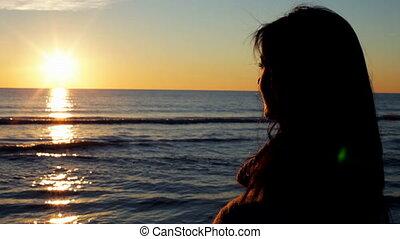 woman watching wonderful sunset