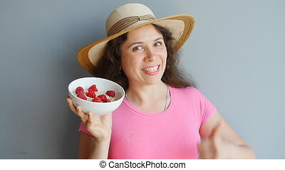 Happy Woman with a bowl of oatmeal and berries