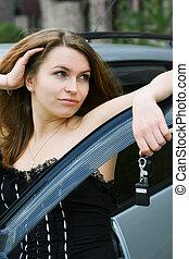 Happy woman with a car key