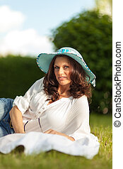 happy woman with a hat outdoors