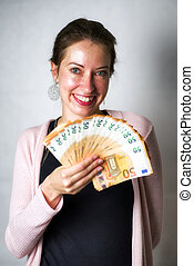 Happy woman with a lot of money