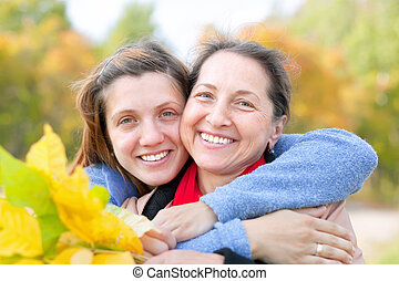 Happy   woman with adult daughter