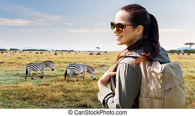 happy woman with backpack traveling in africa - travel,...