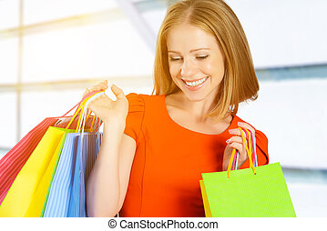 happy woman with bag on a shopping in mall
