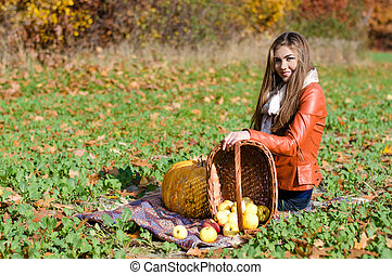 a3c5be2a27f19 Happy old woman with basket harvesting sunflowers. Portrait of a ...
