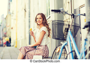 happy woman with bike and ice cream