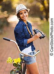 happy woman with binoculars outdoors - portrait of happy...