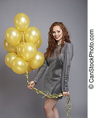 Happy woman with bunch of balloons