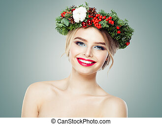 Happy woman with Christmas garland smiling on white