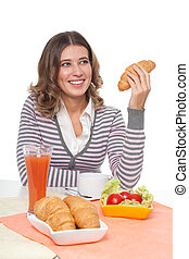 Happy woman with croissant