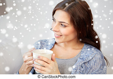 happy woman with cup of tea at home