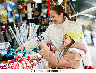 Happy woman with  daughter buying gifts