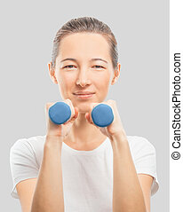 Happy woman with dumbbells