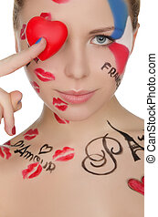 happy woman with face art on theme of France