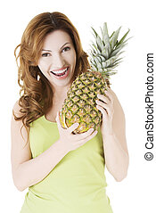 Happy woman with fresh pineapple fruit