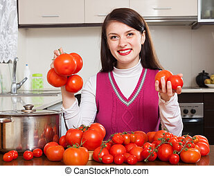Happy woman with fresh tomatoes