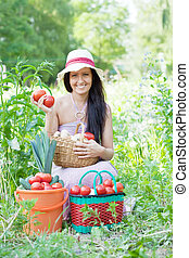 Happy  woman with harvested vegetables