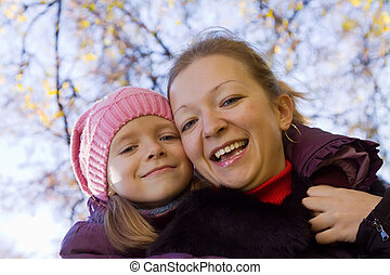 Happy woman with her daughter