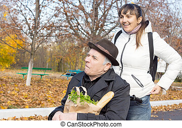 Happy woman with her elderly disabled father