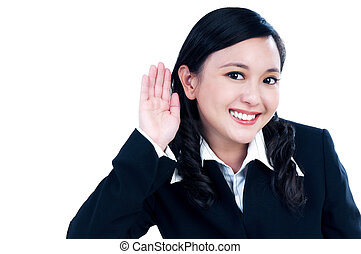 Happy woman with her hand over ear