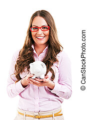 Happy woman with her savings in a piggy bank - isolated
