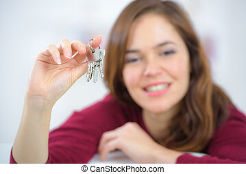 happy woman with home key