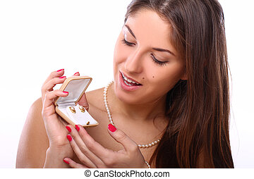 Happy woman with jewels in box  over white background