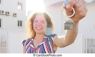 Happy woman with keys at home