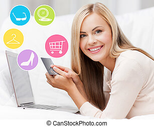 happy woman with laptop and credit card shopping - online...