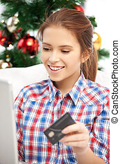 woman with laptop computer and credit card