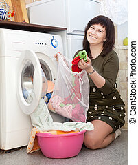 Happy woman with laundry bag