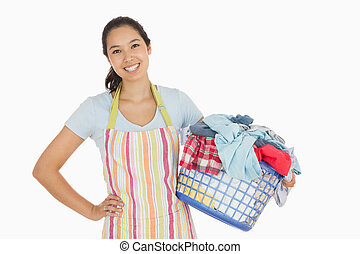 Happy woman with laundry basket - Happy woman in apron ...