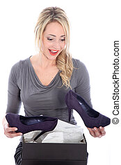 Happy woman with new shoes - Blonde woman is thrilled with...