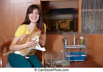 Happy woman with pets in home