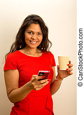 happy woman with phone and coffee