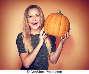 Happy woman with pumpkin