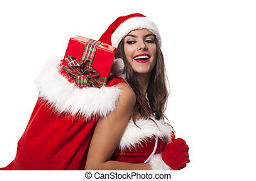 Happy woman with sack of santa claus