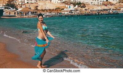Happy Woman with Scarf Walking on the Summer Beach in Slow Motion