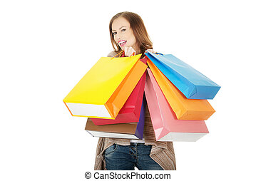 Happy woman with shopping bags.