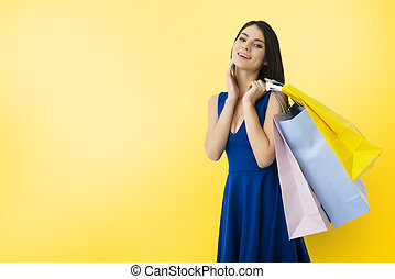 Happy woman with shopping bags in hand