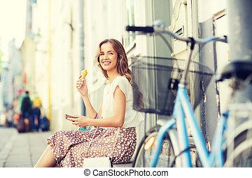 happy woman with smartphone, bike and ice cream
