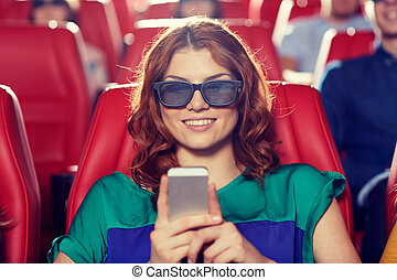 happy woman with smartphone in 3d movie theater - cinema, ...
