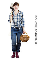 Happy woman with spade and basket - Happy young woman with...