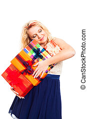 Happy woman with stack of gift boxes
