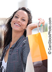Happy woman with store bags