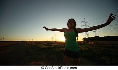 Happy Woman with Sundown