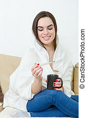Happy woman with thermometer healed of colds